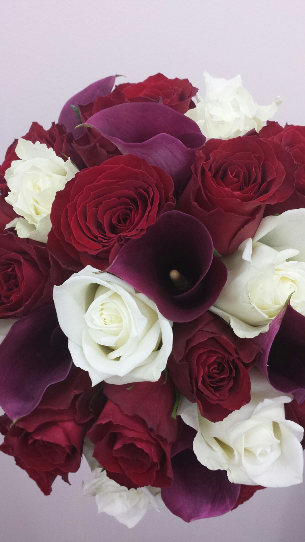 roses and calla lilies