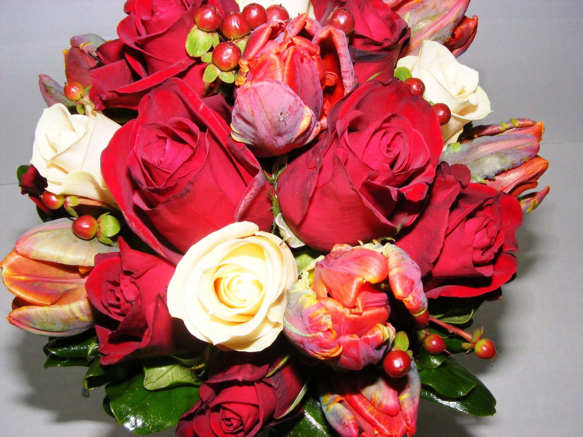 Red parrot tulips with red and champagne rose bridal bouquet