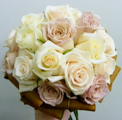 latte rose tones with magnolia foliage