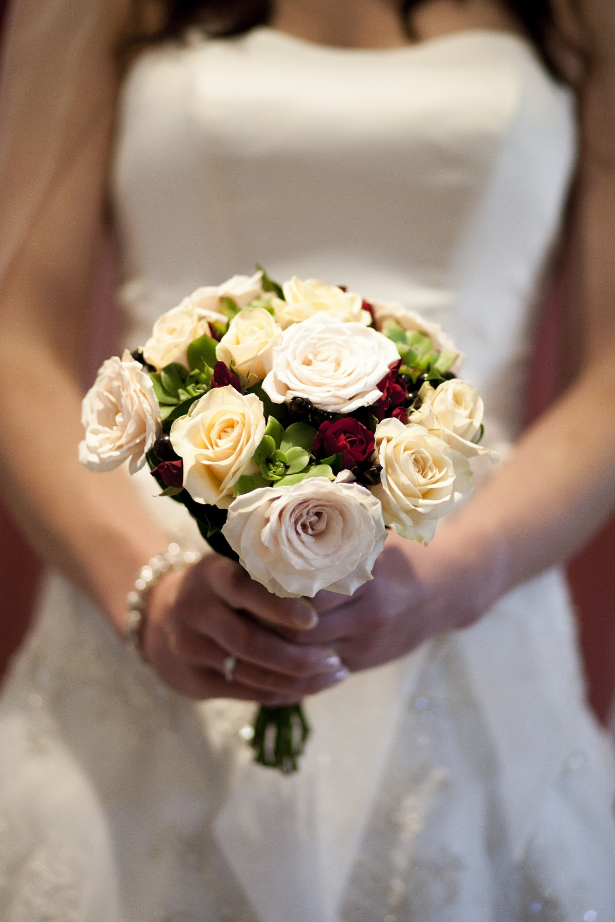 champagne roses and berries bridal posy