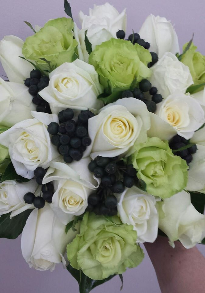 green and white roses with berries