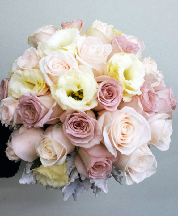 roses and lisianthus with dusty miller foliage
