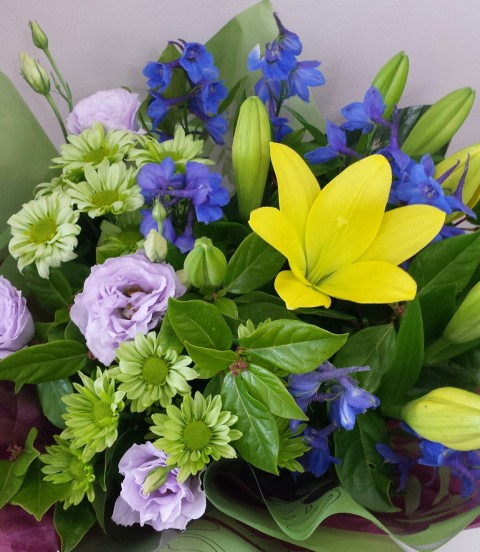 Bright selection of seasonal flowers wrapped to present