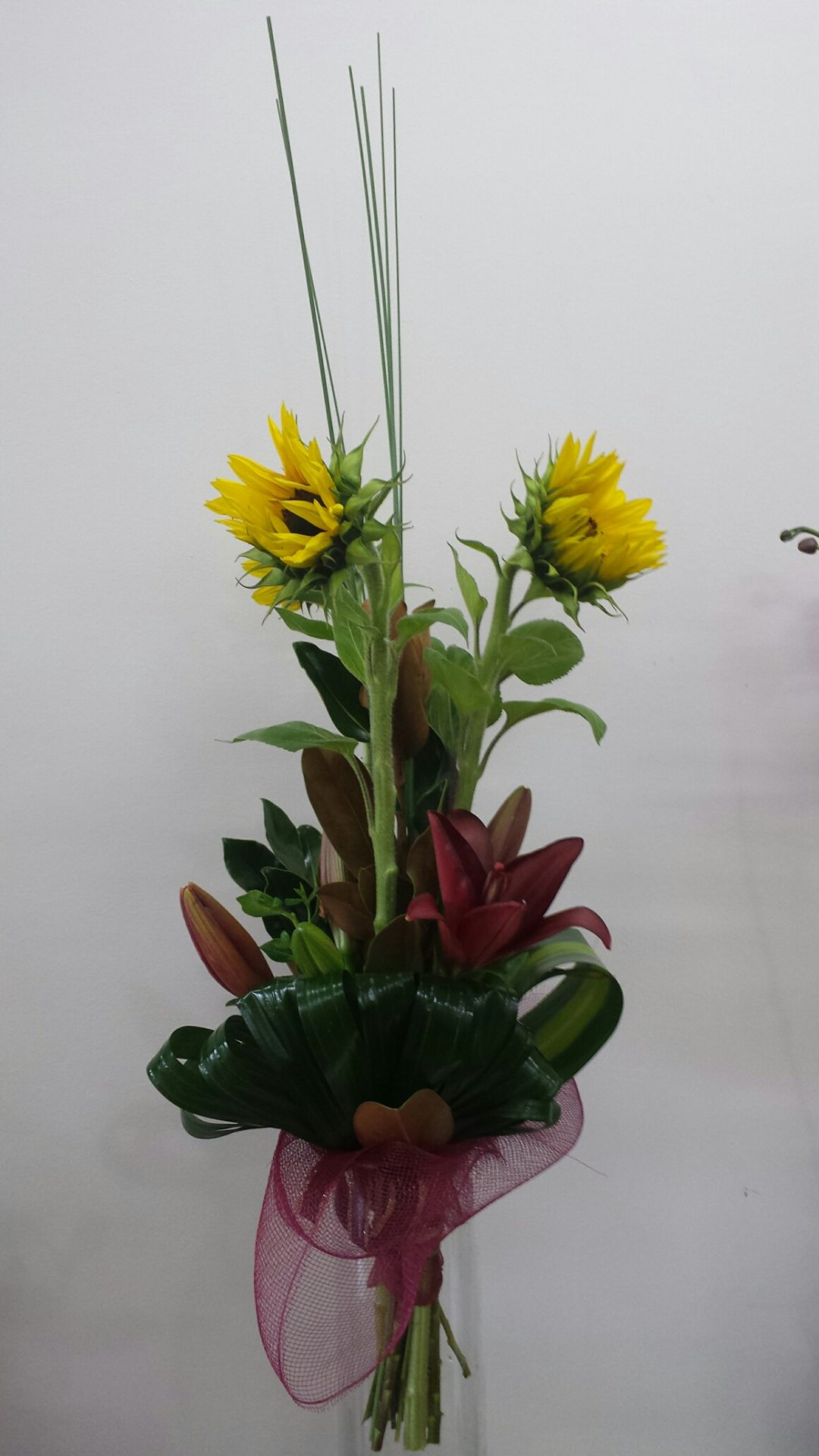 Presentation bouquet of sunflowers and lilies