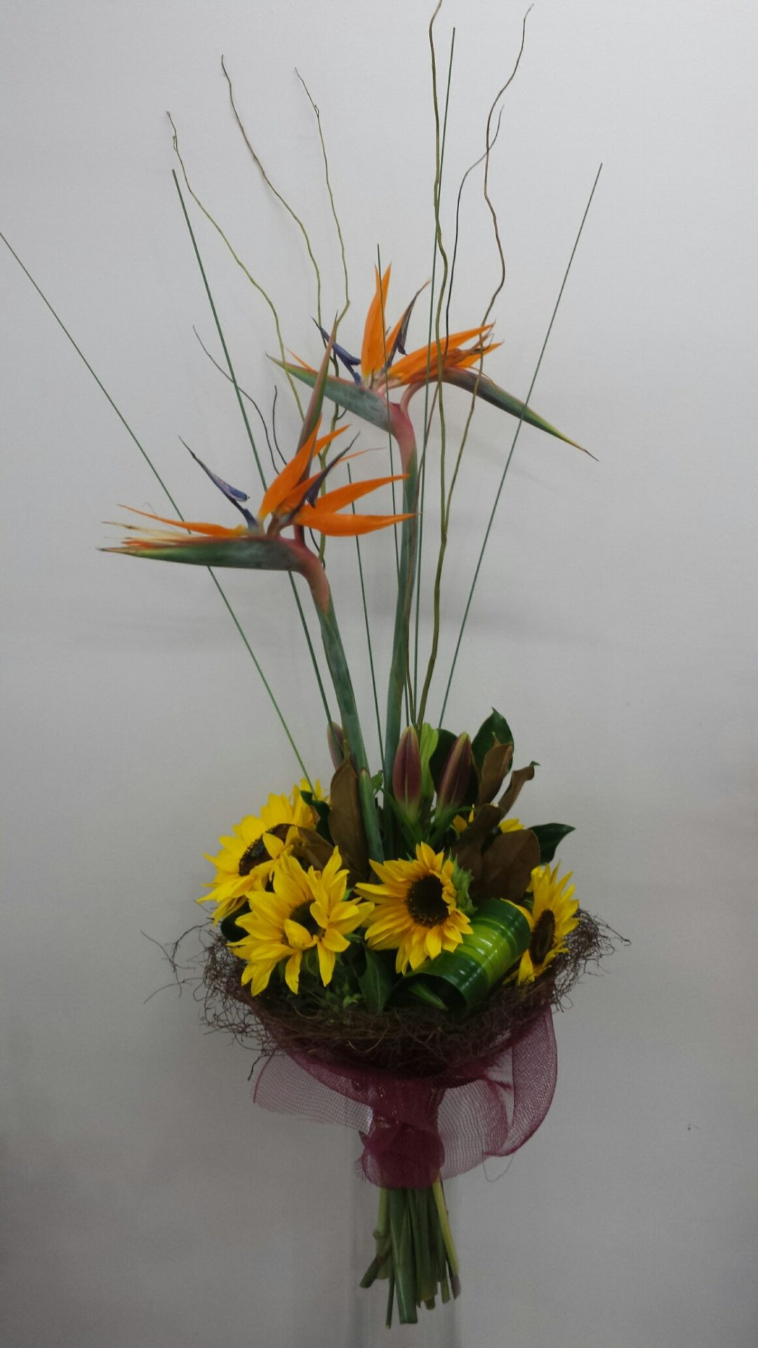 Presentation bouquet of Bird of paradise and sunflower