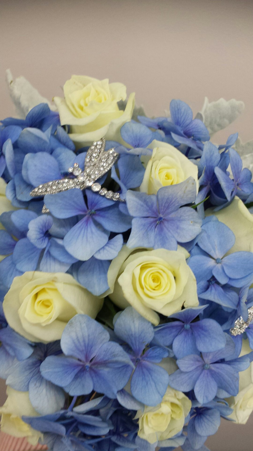 Blue hydrangea and white roses