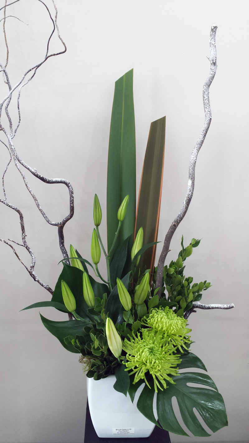 Corporate-Snow-Design with frosted branches and oriental lilies