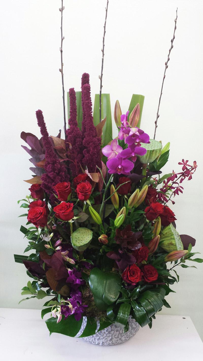 Event arrangement in stoneware pot by Blackwood Florist