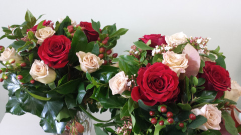 Red and Honeymoon roses with hypericum berries and foliage