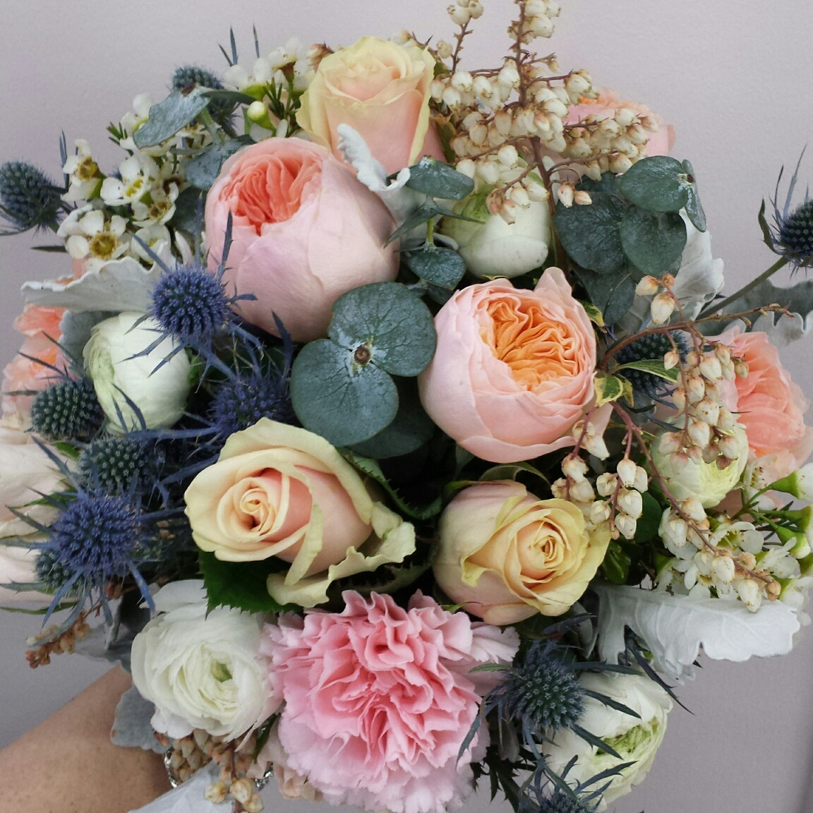 sea holly, garden roses, andromeda and carnation