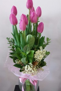 Tulips arranged in a glass vase.