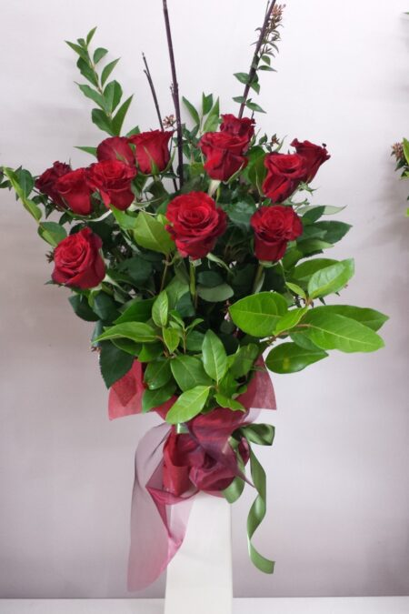 Red rose bouquet in a ceramic vase