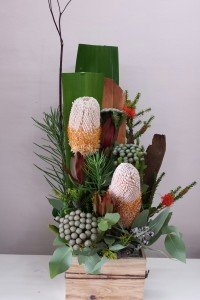 Mix of seasonal native flowers arranged in a wood box