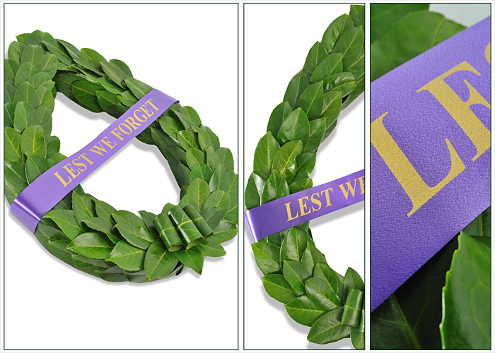 Traditional laurel leaf wreath with Lest We Forget ribbon across