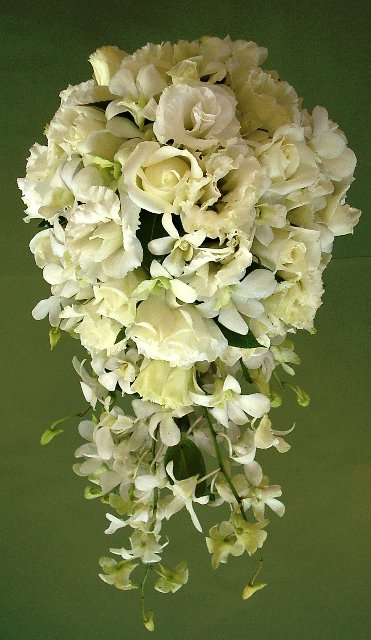 teardrop bridal bouquet with cream roses, orchids and lisianthus