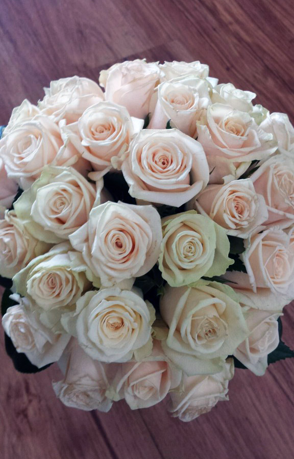cream rose compact style bouquet