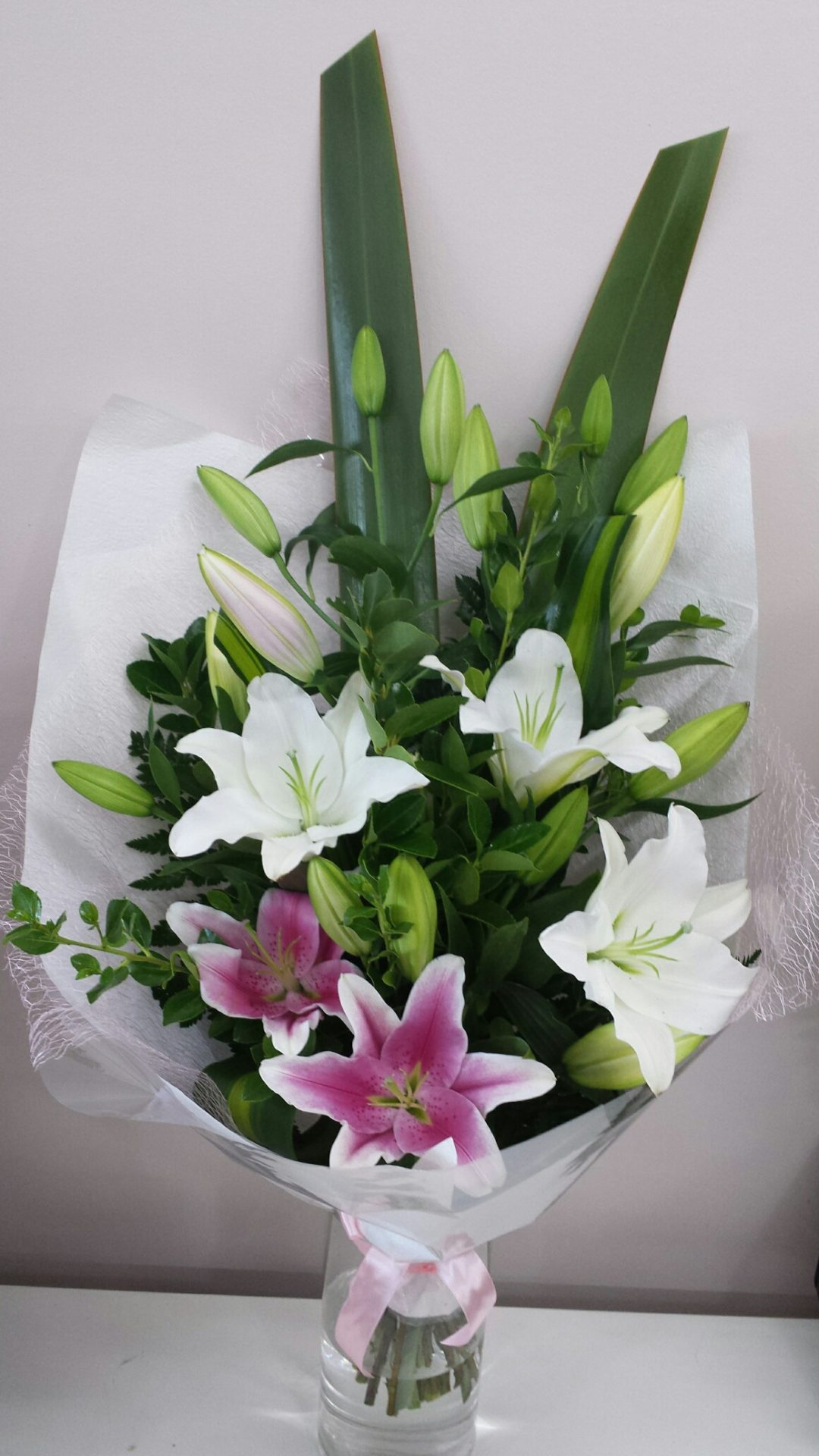 Graduation bouquet of oriental lilies and tropical foliages