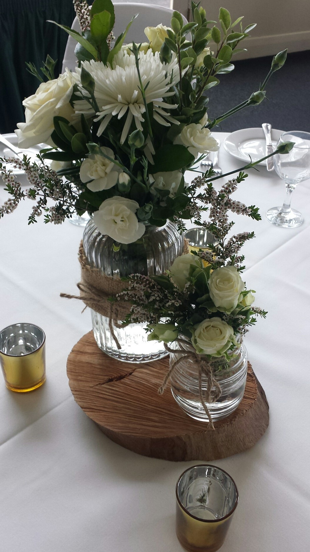 All white vintage vases on wood round