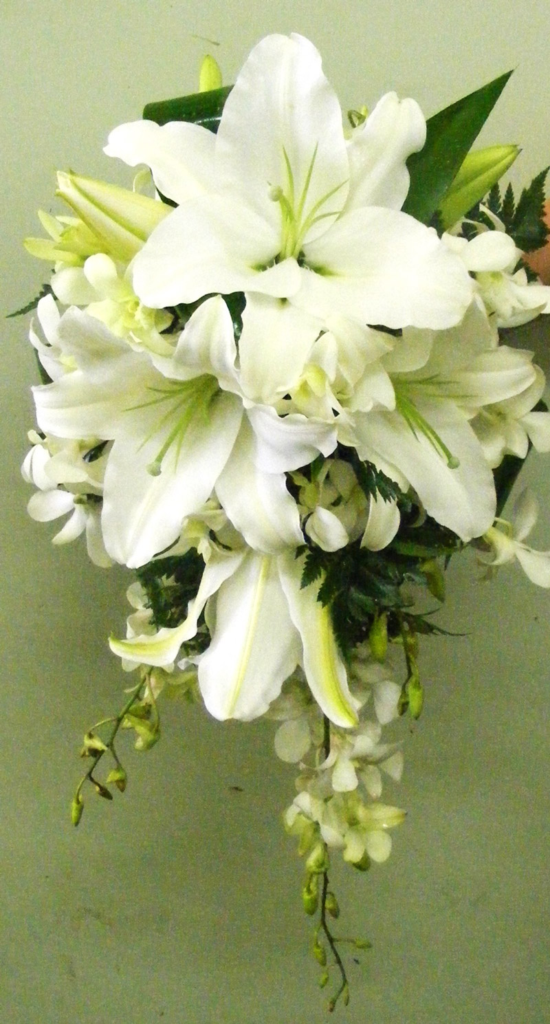 Bridal Bouquet of white oriental lilies and singapore orchids
