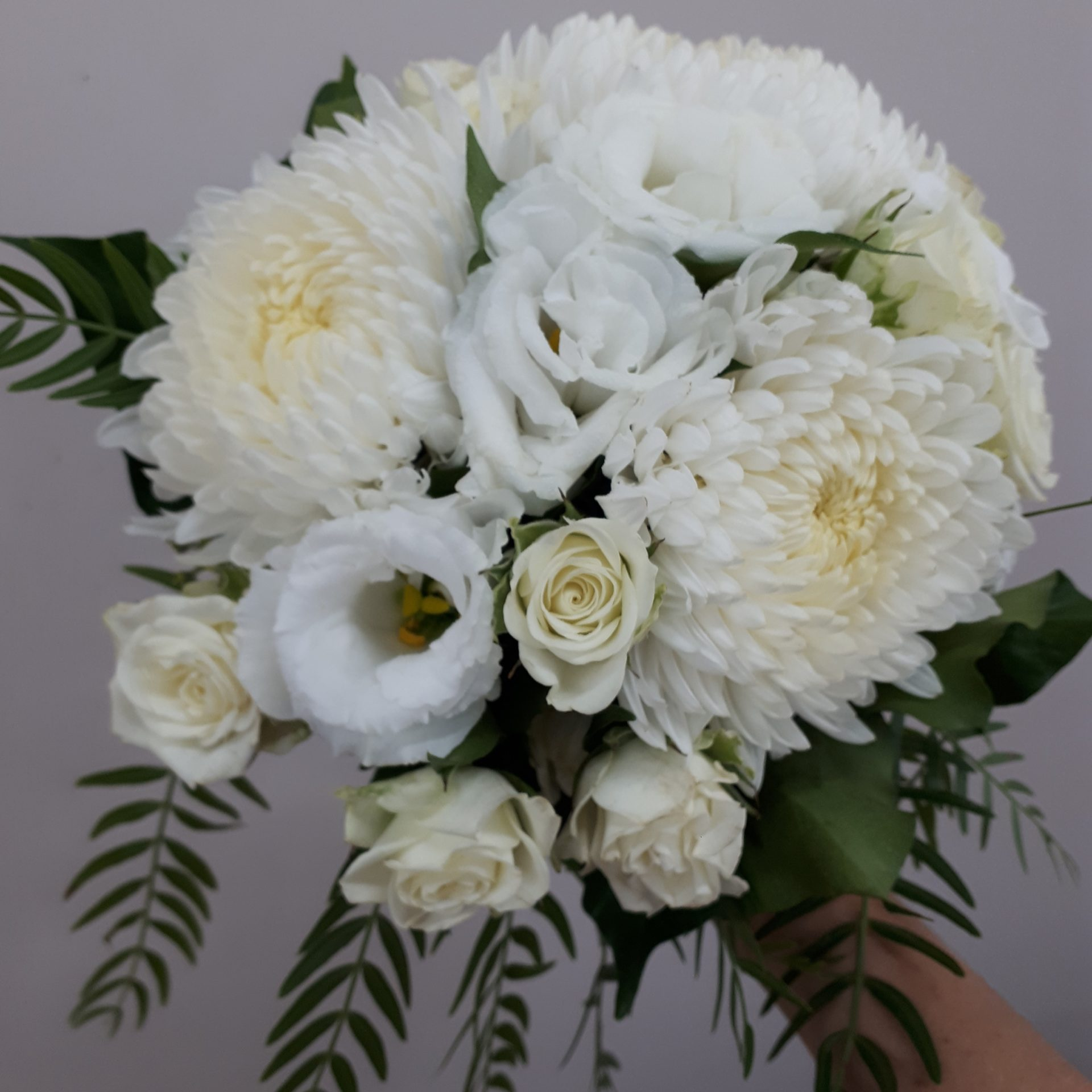 Bridesmaid's cascading posy with cream disbuds, lisianthus and roses