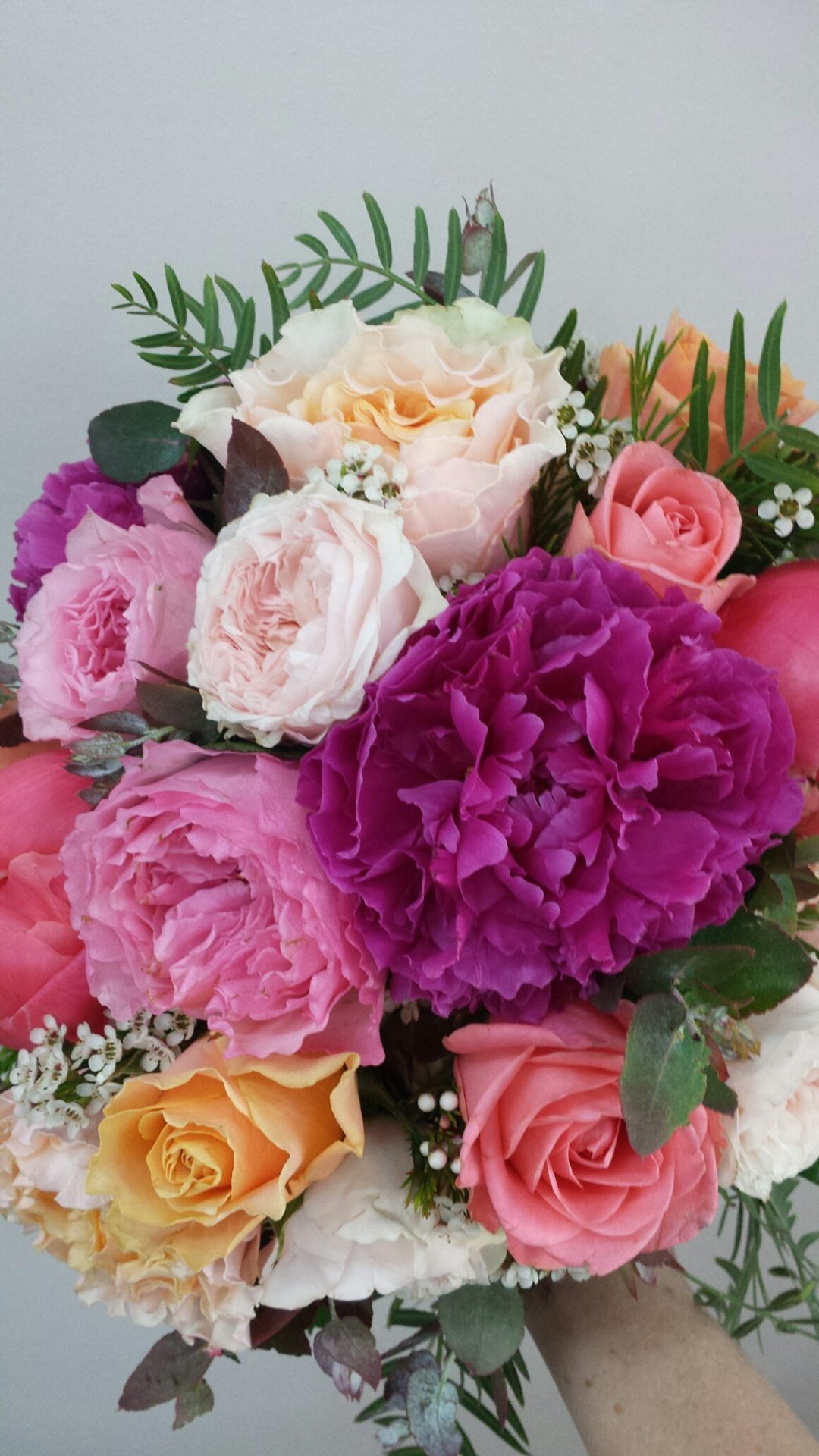 coral-magenta-and-apricot-roses-and-peonies