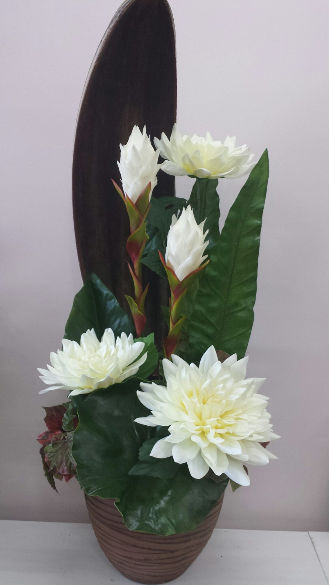 Dahlia and tropical torch design with palm husk