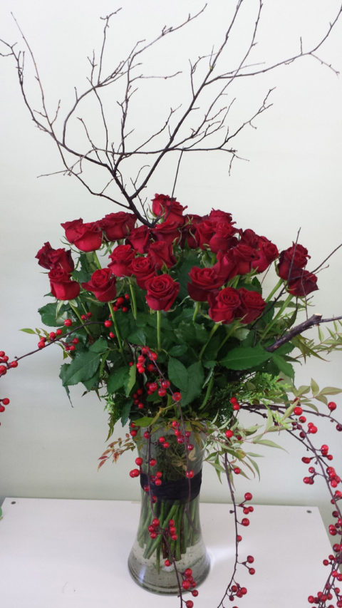 Event design with red roses and berries