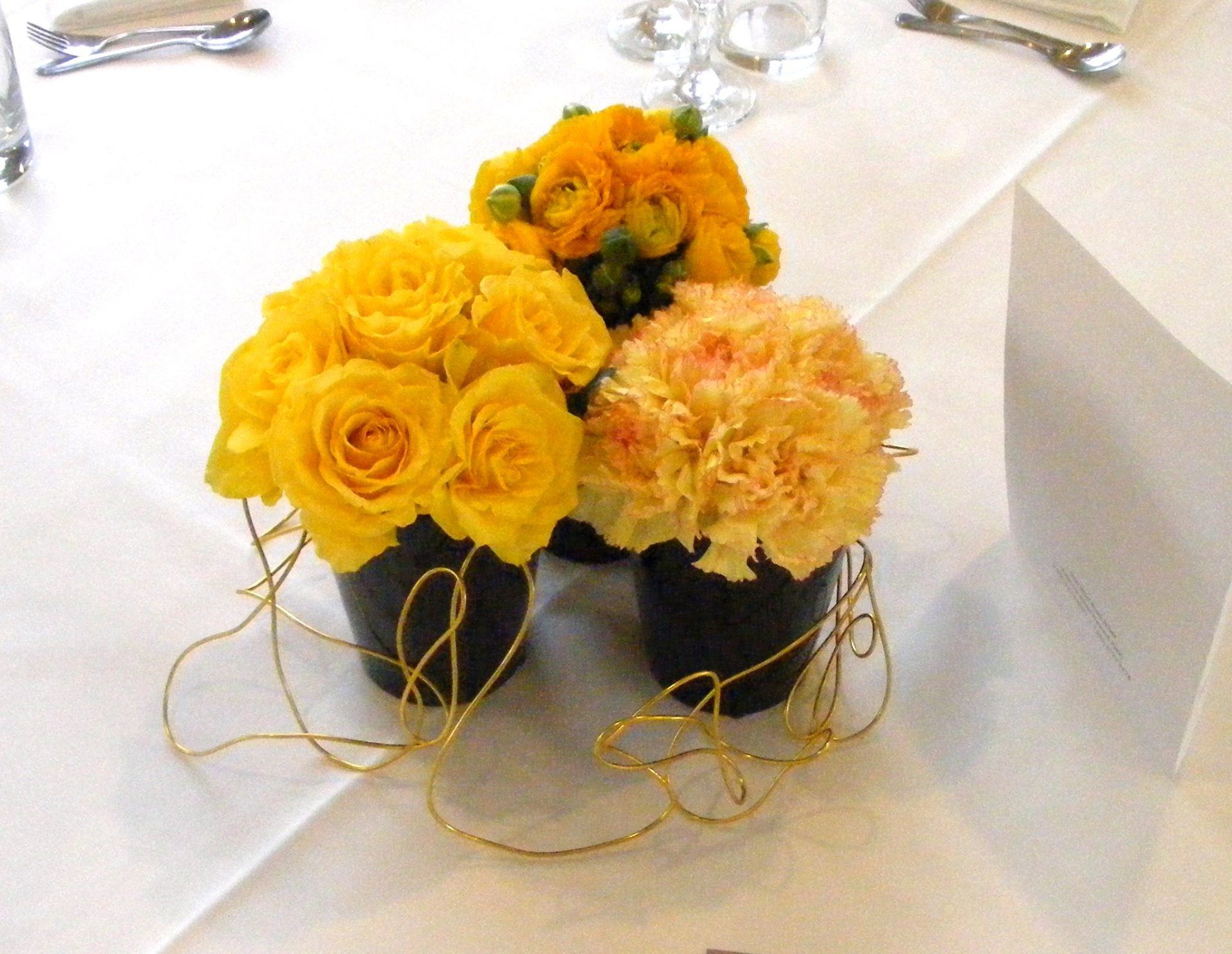 Grouped table centre piece yellow roses