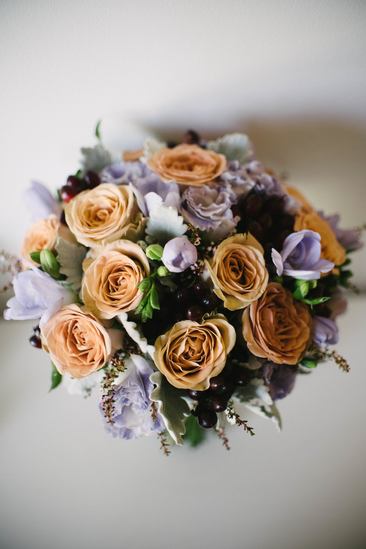 Honeymoon roses, mauve freesia and plum hypericum berry bouquet
