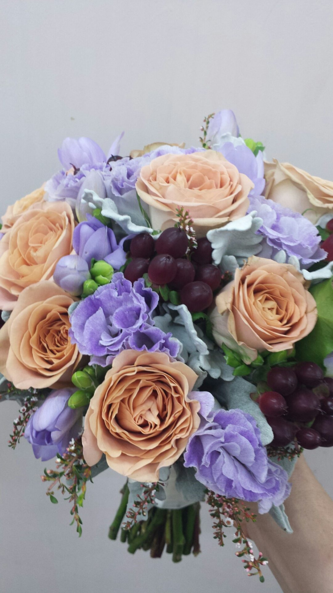Honeymoon roses, mauve lisianthus and hypericum berry