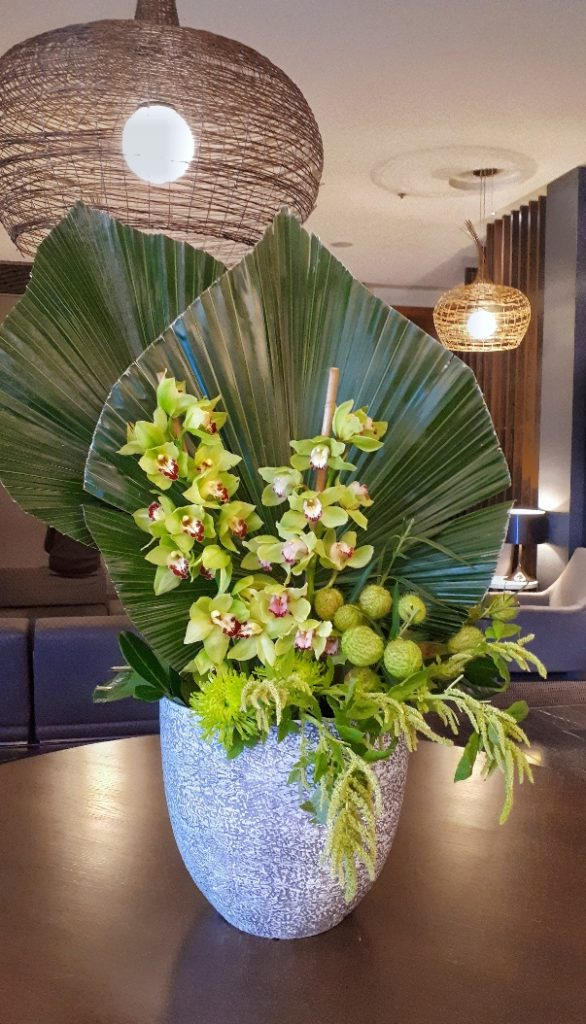 Large corporate deisgn with green orchids and Palm hearts