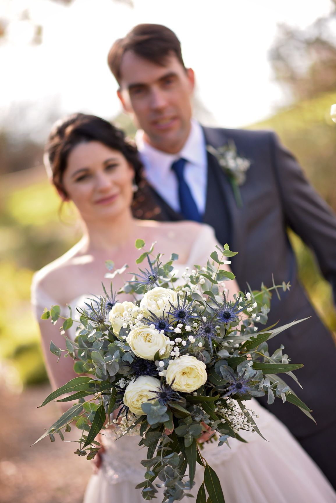 Loose Blugum style bouquet with garden roses and sea holly