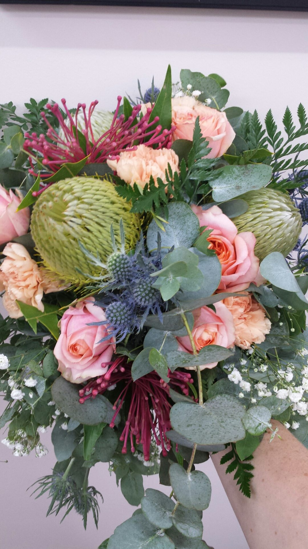 Loose trailing gum, seaholly and garden roses
