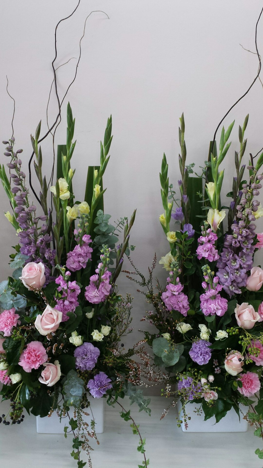Matching pedestal arrangements in soft pink and lavender