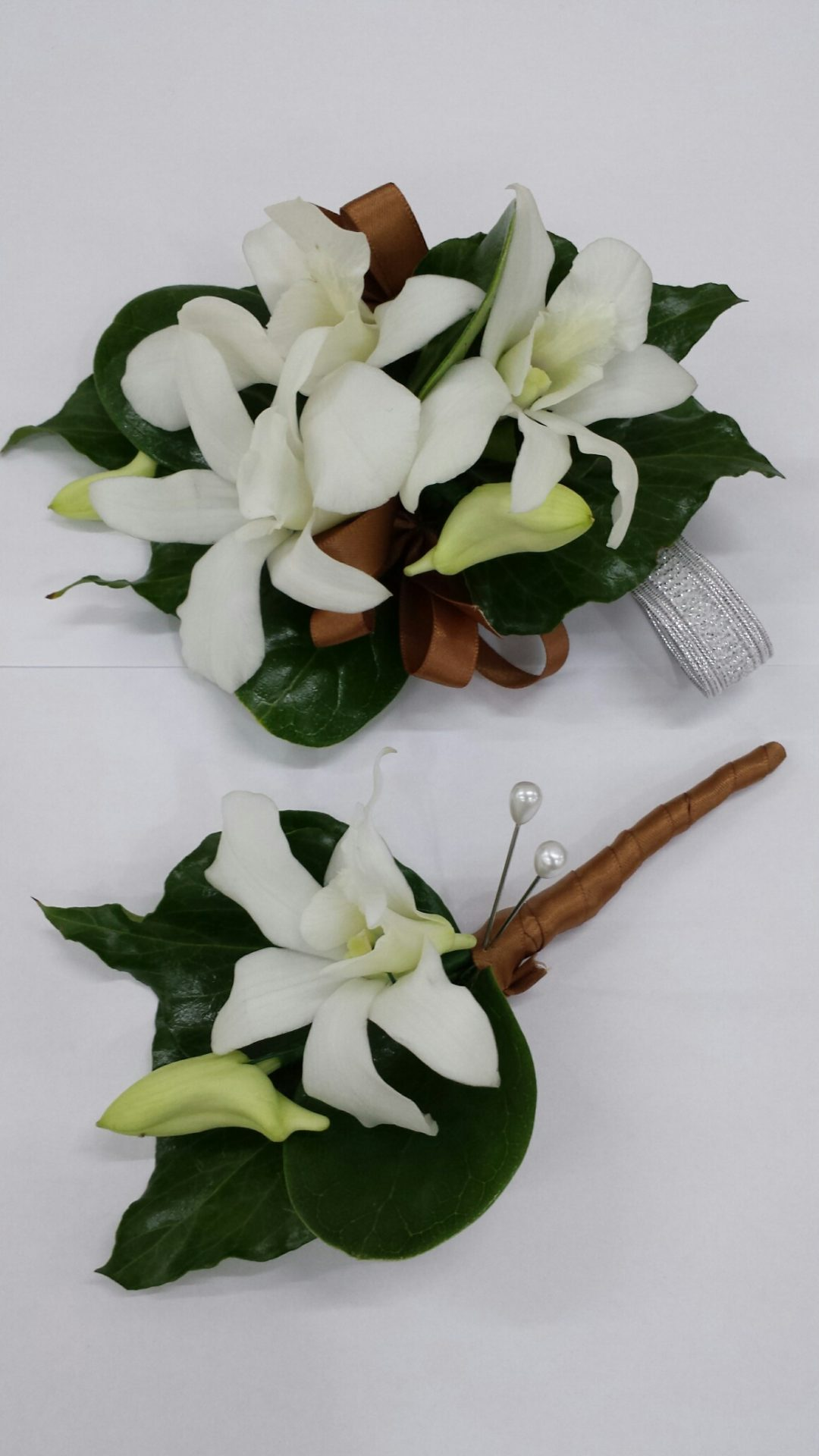 Matching set corsage and buttonhole white orchids gold ribbon