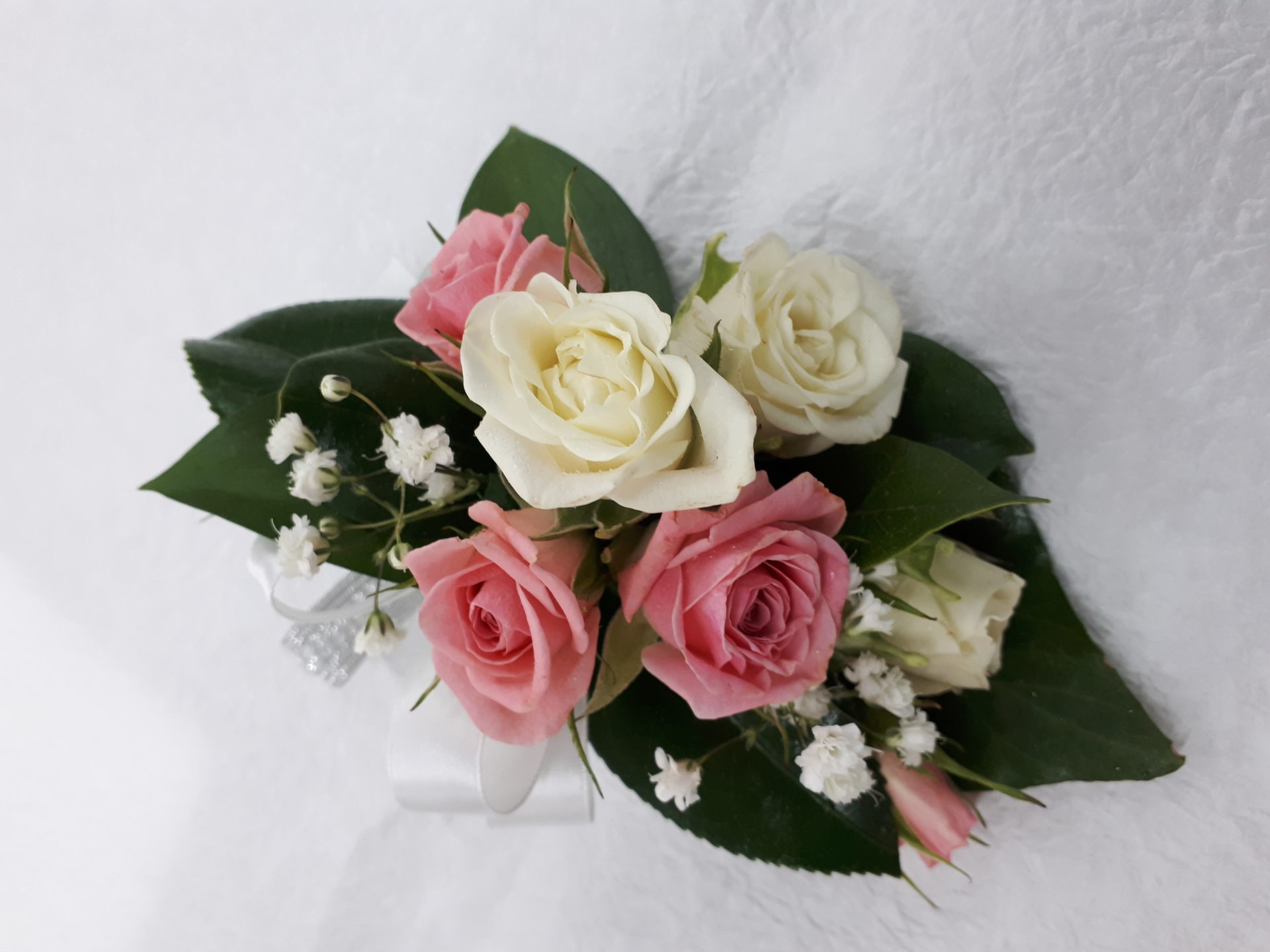 Pink and white spray roses with gyp