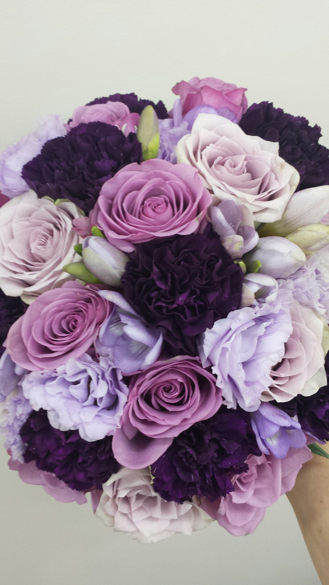 Purple and mauve compact bridal bouquet
