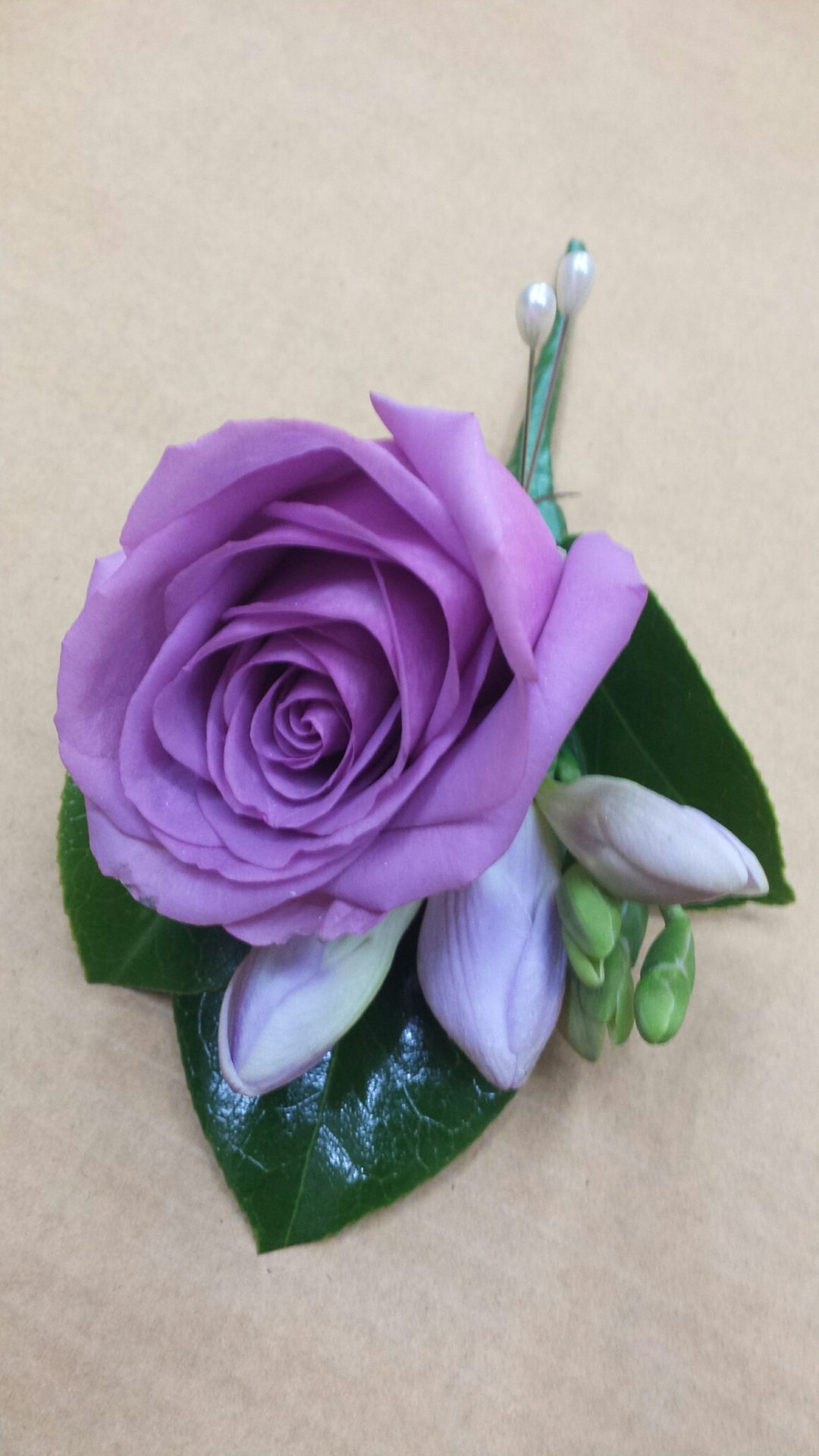 Purple rose and freesia buttonhole