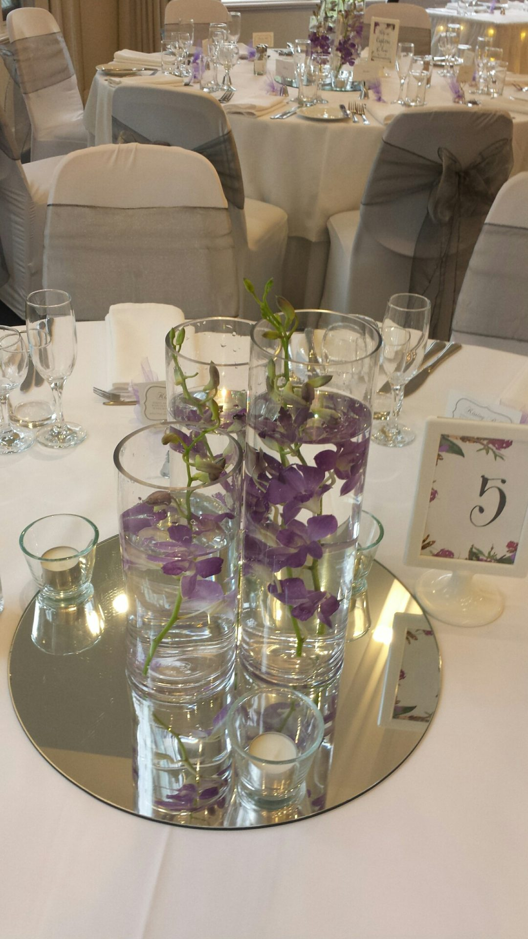 Purple submerged orchid table setting