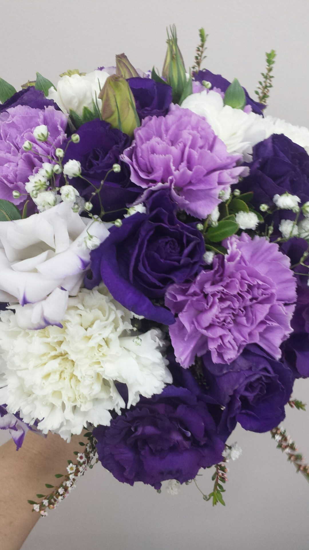 Purple toned Lisianthus and carnations