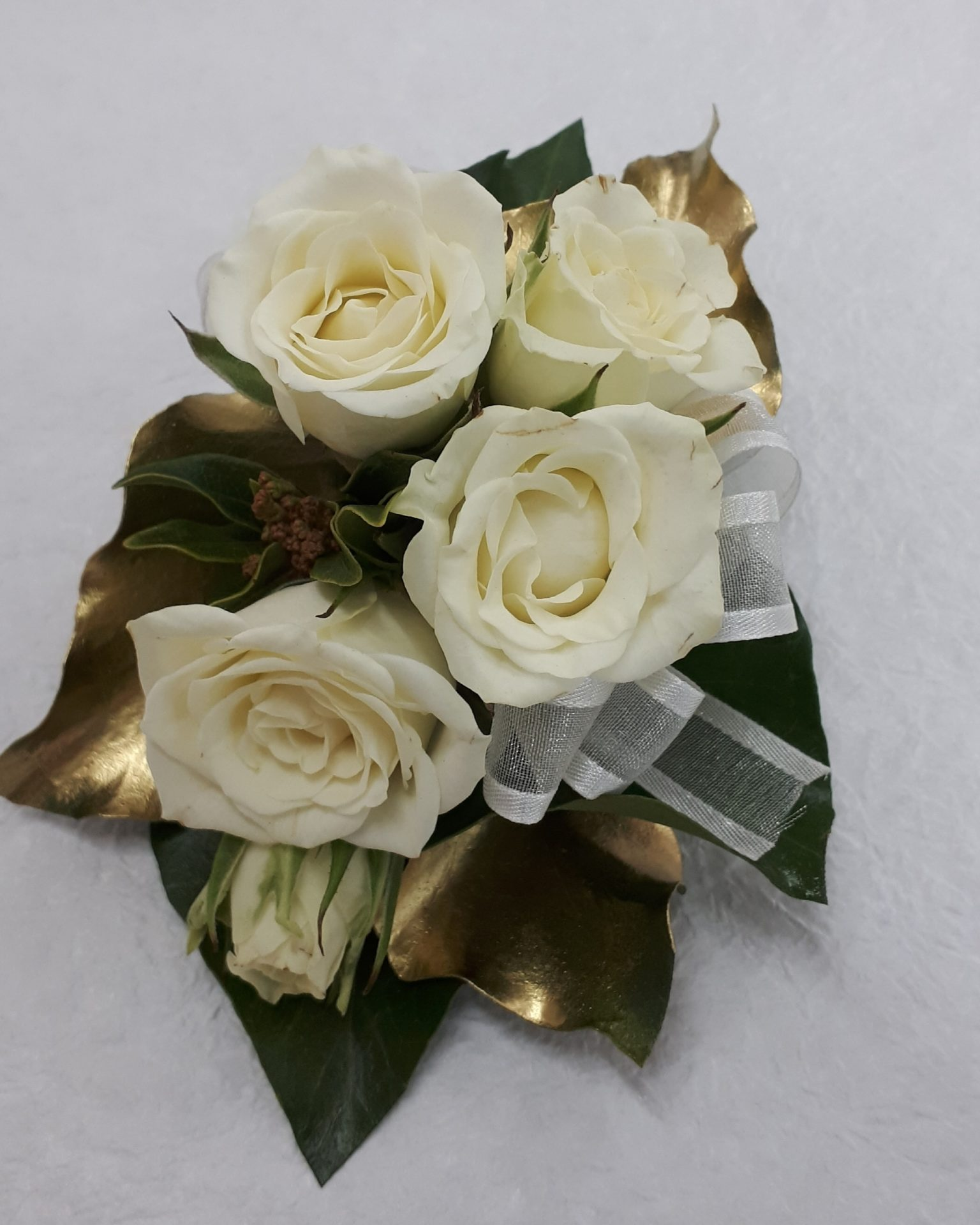 Roses with gold leaves and ribbon corsage