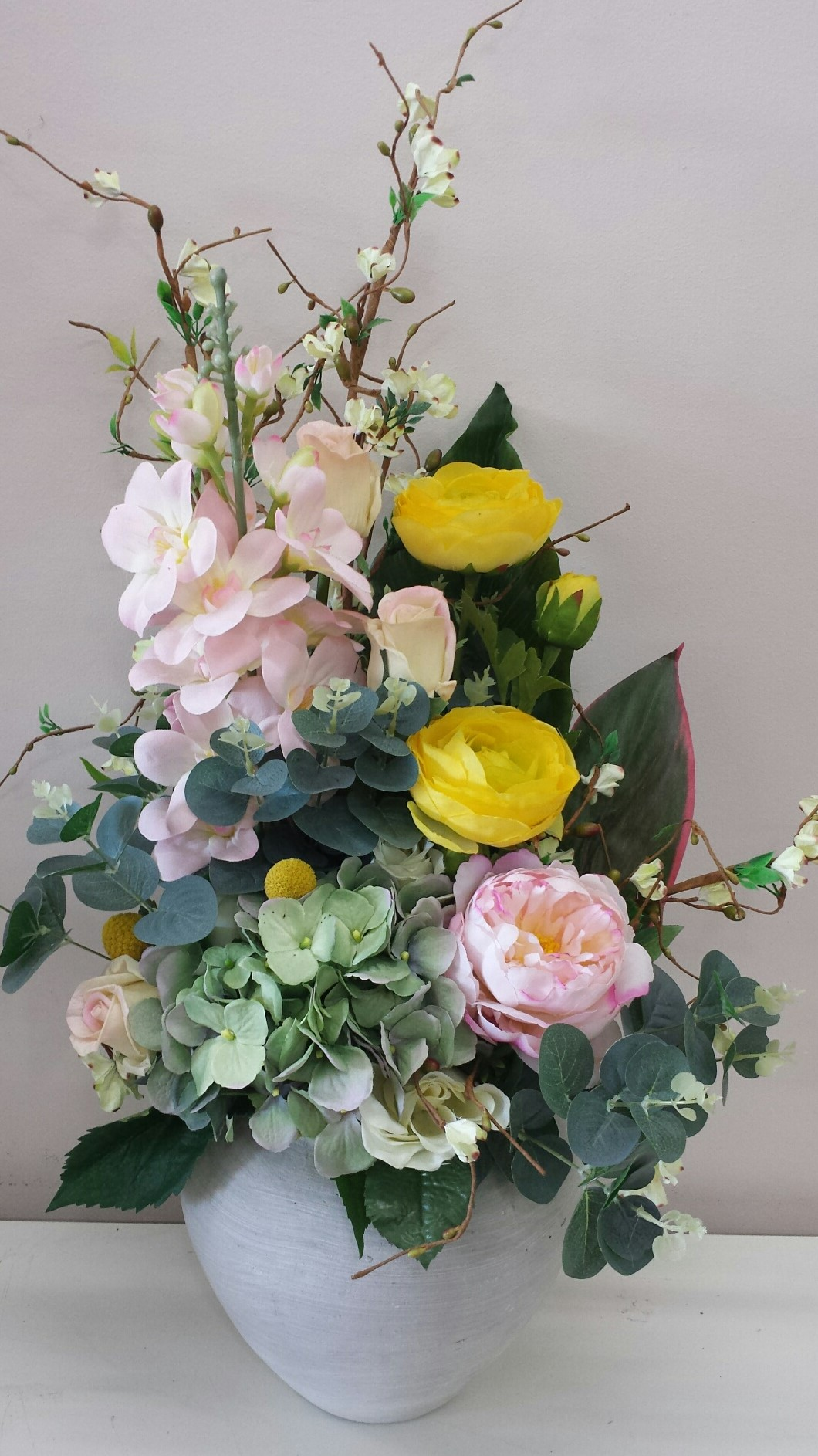 Sping blooms with billy buttons and blue gum