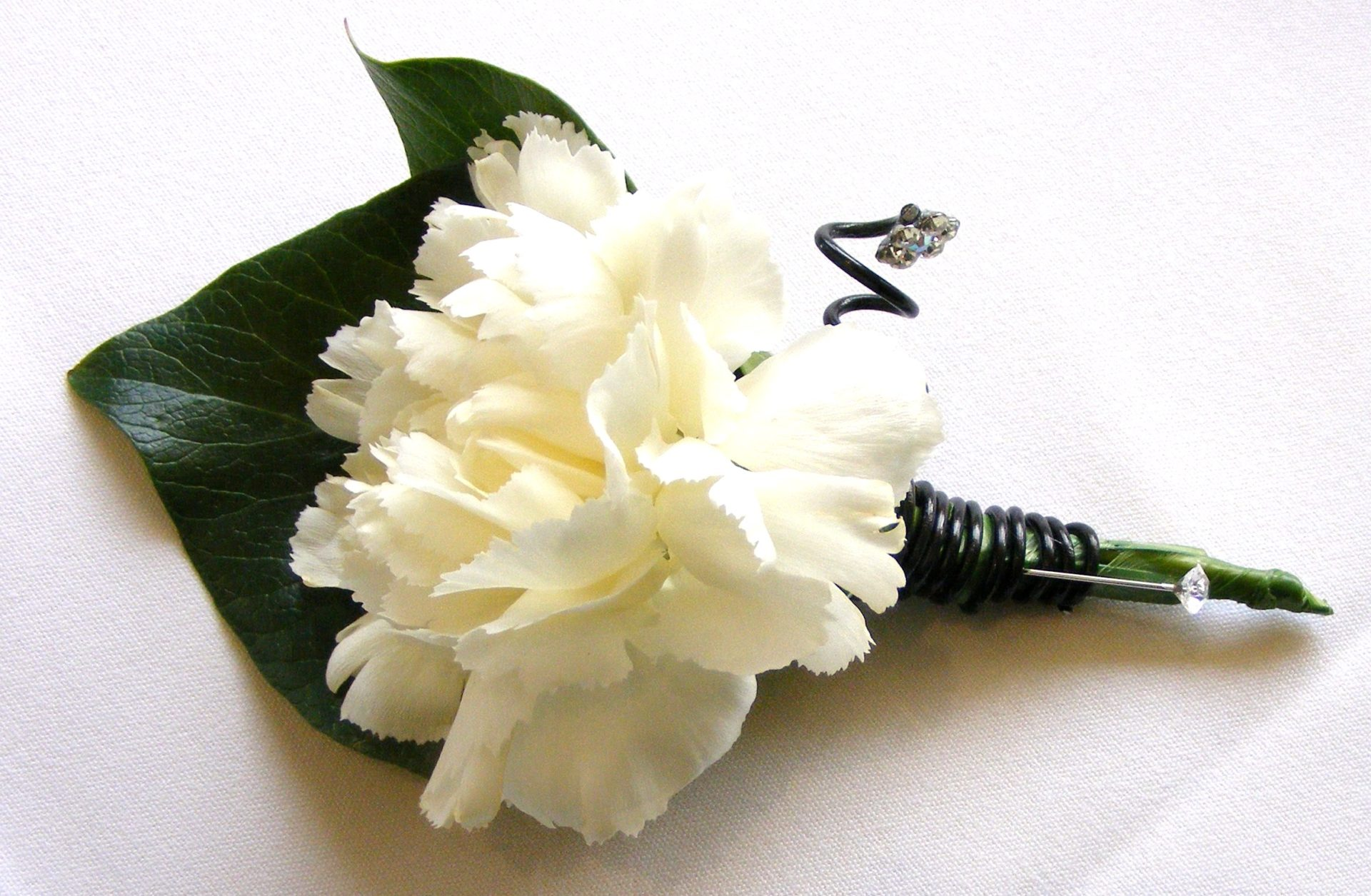 White carnation buttonhole with decorative wire