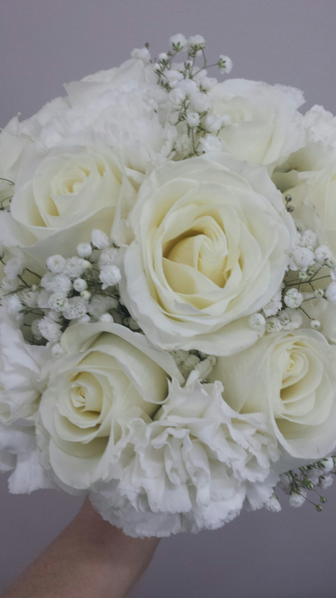 White roses, carnations and Babies breath