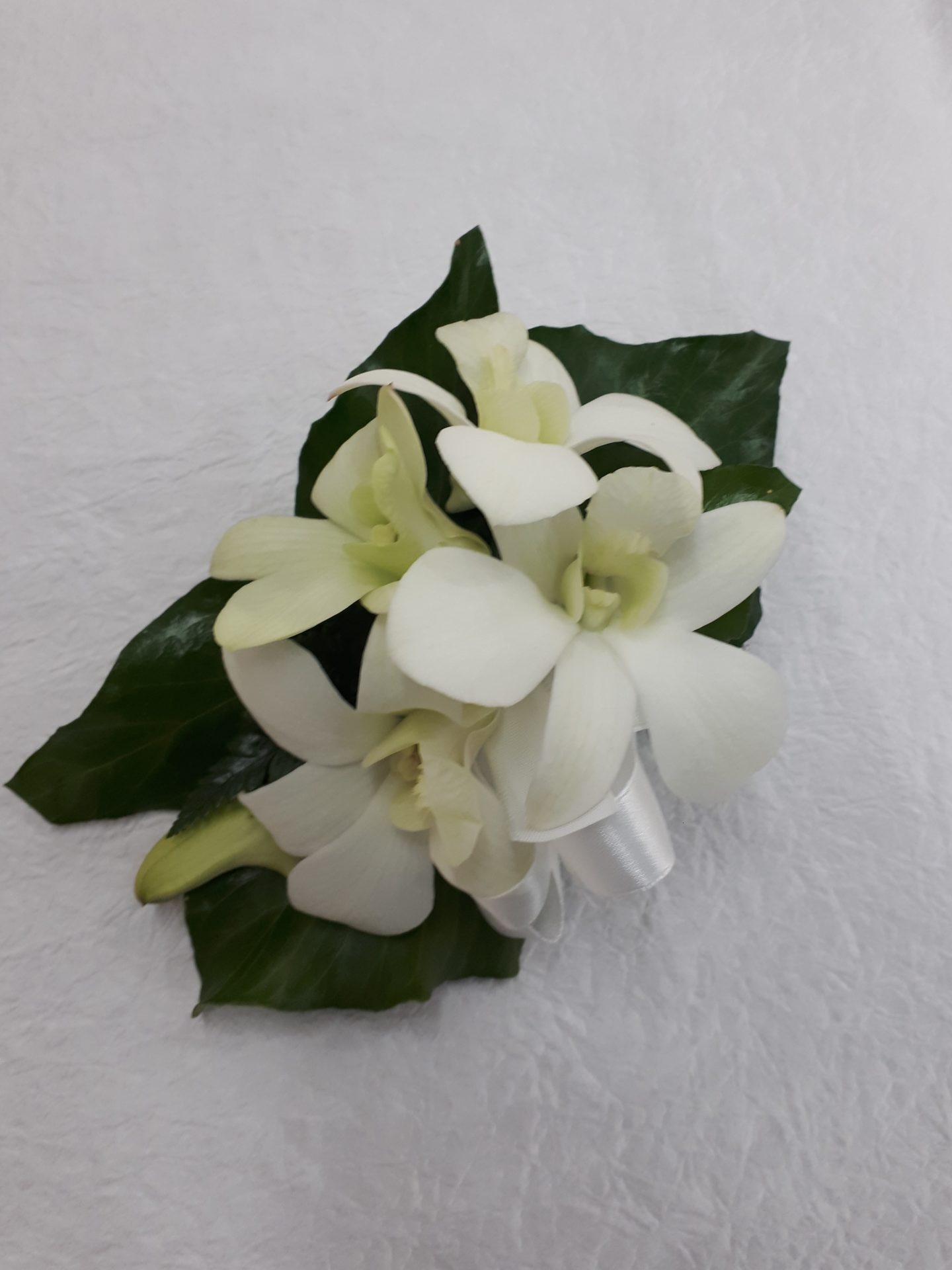 White singapore orchid corsage
