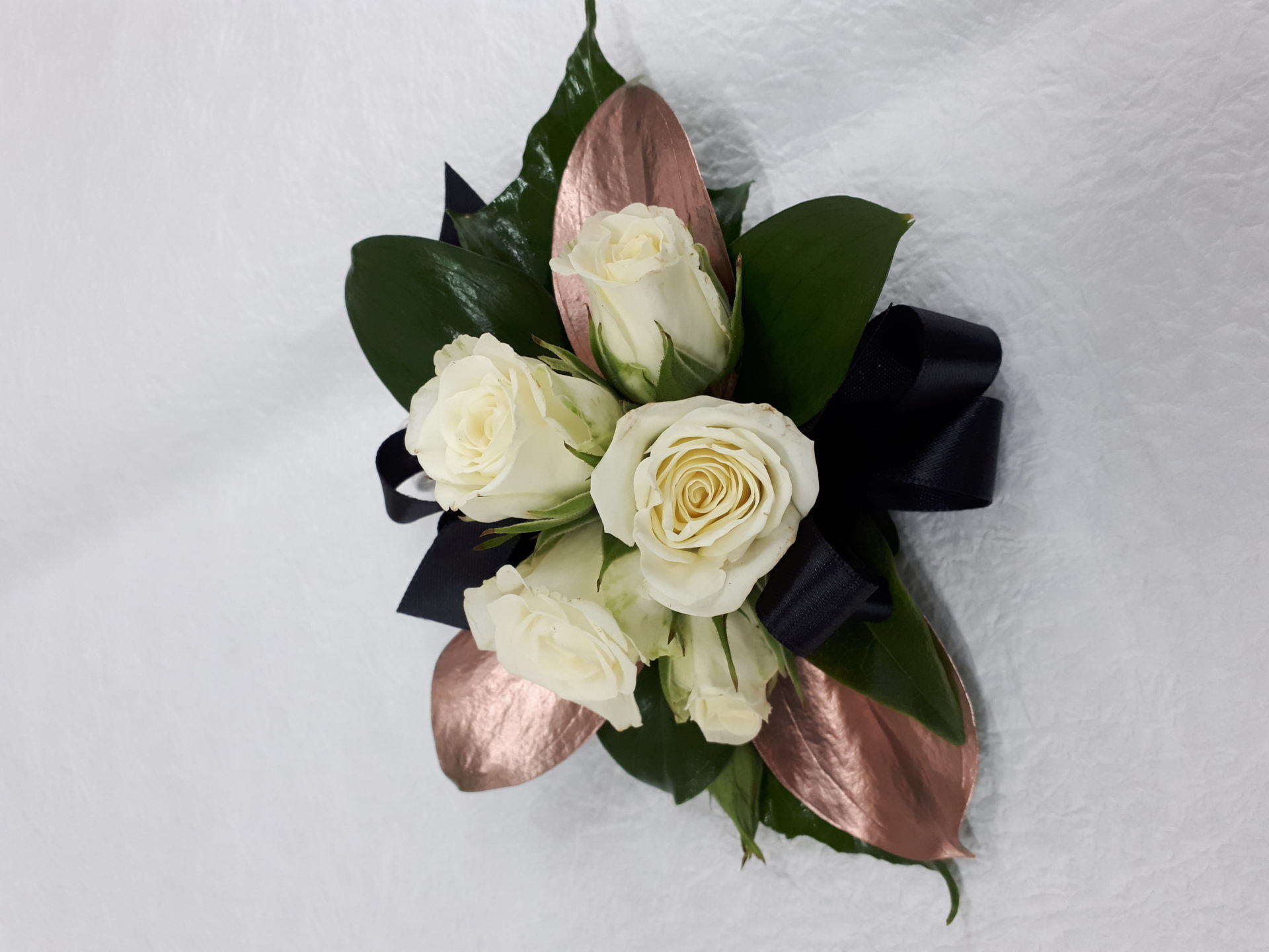 White spray roses with rose gold leaves