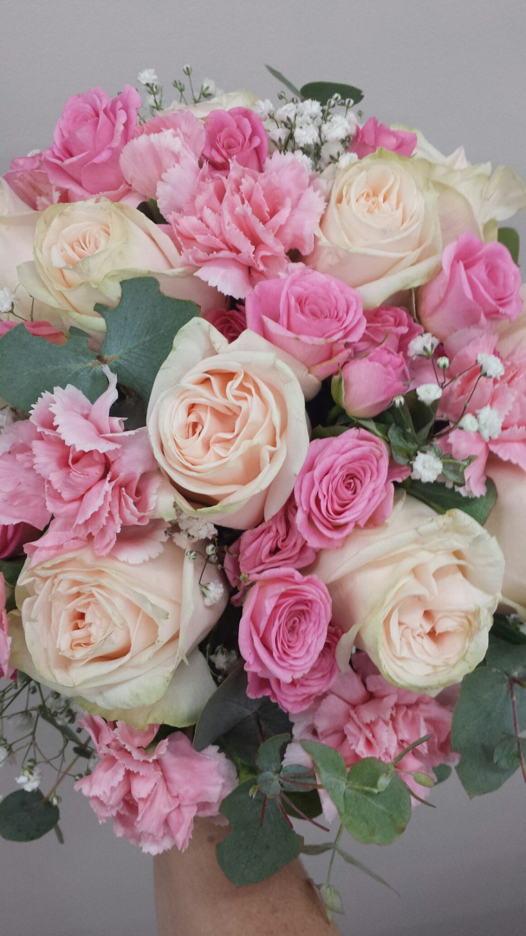 blue gum with soft pink roses, spray roses and spray carnations