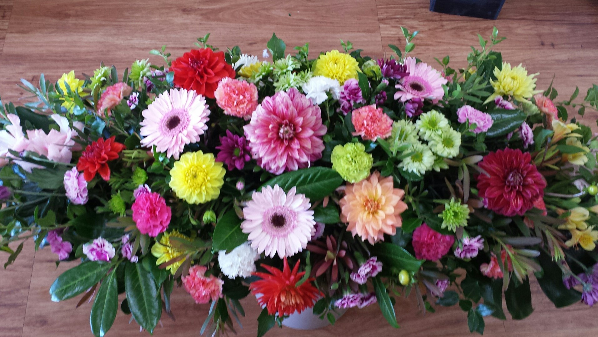 bright mixed flower casket spray
