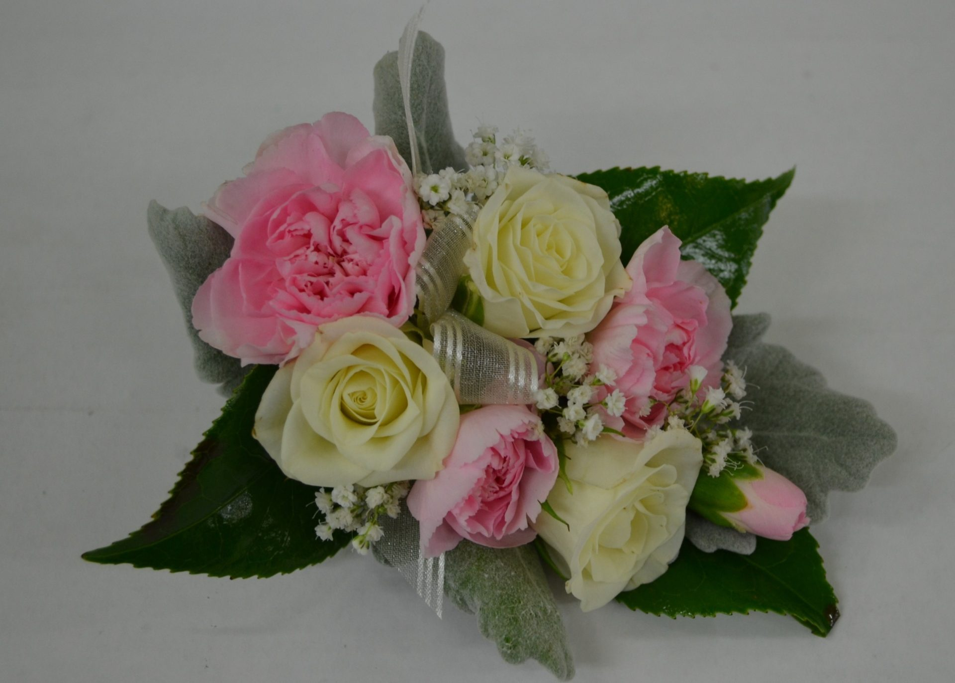corsage pink & white spray roses and carnations.
