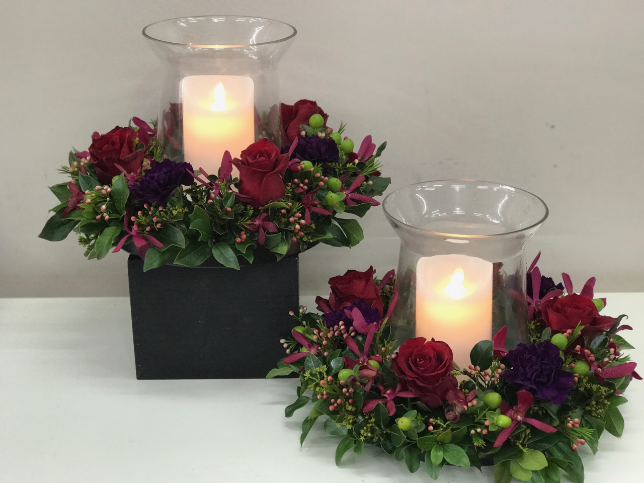 flower wreath with vase and candle centre